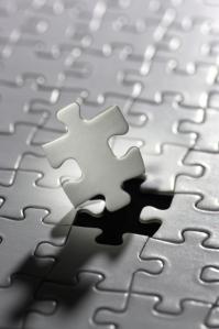 Illuminated puzzle piece.(vertical)