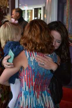 One of my favorite mothers, my friend Casey, and my chosen child, McKinley surprising me at the launch party.